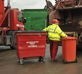 John Wheeldon with two wheelie bins