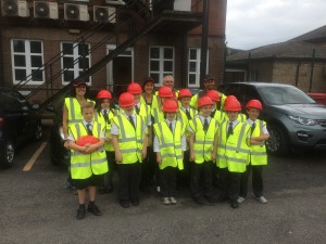 wheeldon brothers with heap bridge primary school in carpark